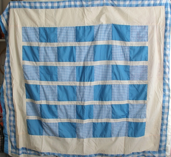 Quilt top made with solid blue squares and blue and white checked squares