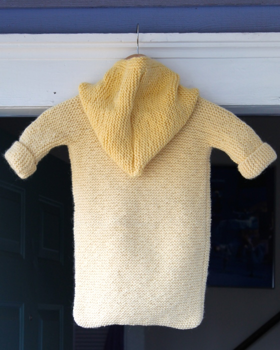 Back of baby sleep sack made from yellow wool