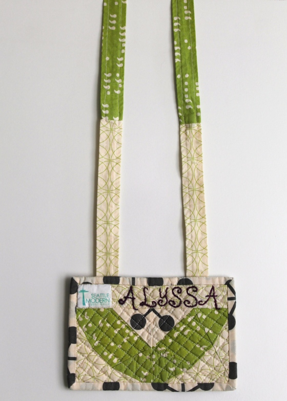 Modern Quilt Guild name tag made with Moda Zen Chic fabric in green, black, and cream