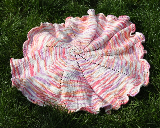 Spiral baby blanket made from variegated pink cotton yarn