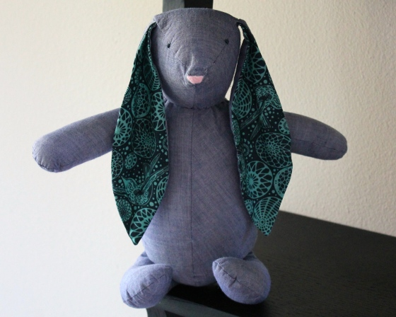 Stuffed bunny made from blue chambray and Tula Pink fabric
