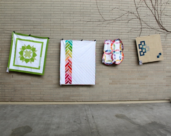 assortment of modern quilts at Northwest Folklife (from Seattle Modern Quilt Guild)