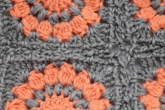 Close up of coral and gray granny squares