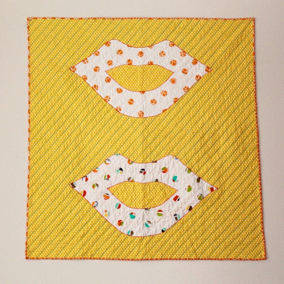 Wall hanging quilt with lips on it, andy warhol inspired