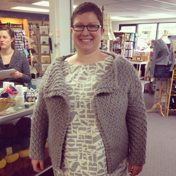 Girl wearing sample of a gray Debbie Bliss designed sweater