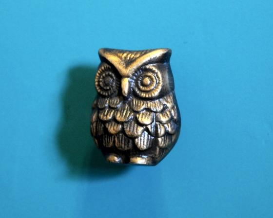 Brass door pull shaped like an owl