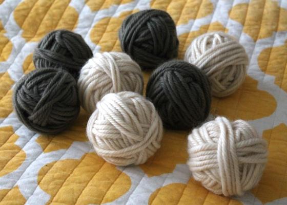 Gray and cream wool yarn balls