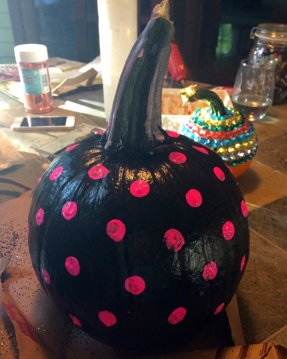 Pumpkin painted black with pink polka dots
