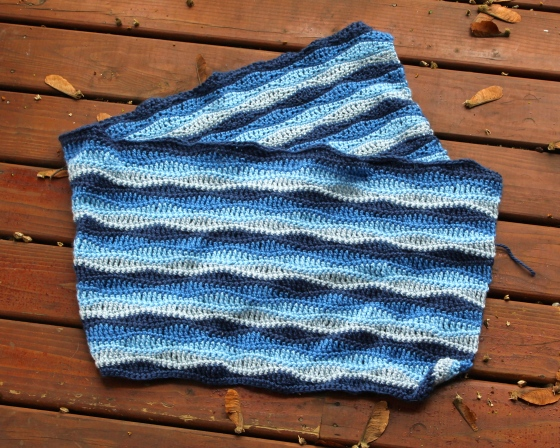 Blue crocheted baby blanket using wave stitch