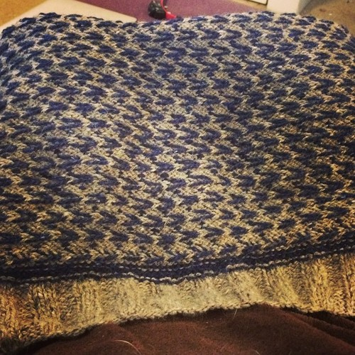 Back of navy and light brown tweed men's sweater