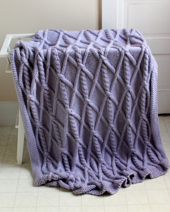 Lavender knit blanket with cables