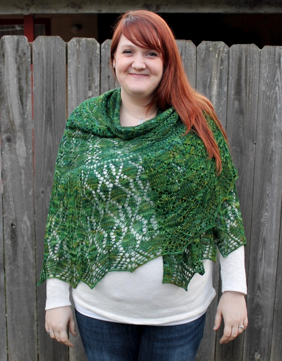 Girl with red hair wearing green lace shawl