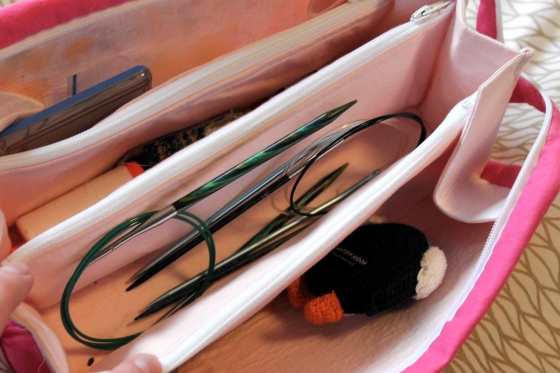 Inside of Sew Together Bag with circular knitting needles and other notions