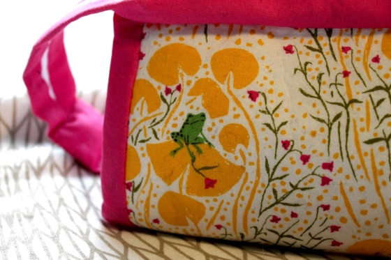 Close up of Sew Together Bag with green frog on yellow lily pad