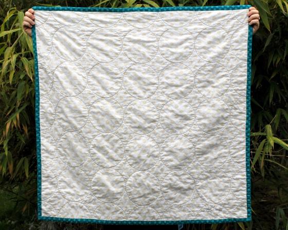 Riley Blake Medium dot Cream on Cream wholecloth quilt, teal binding