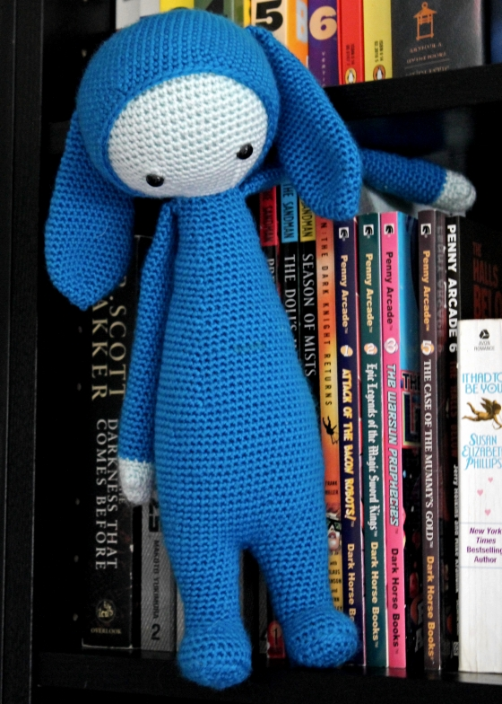 Lalylala Rita the rabbit blue yarn hanging in library