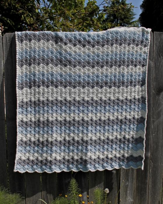 Tunisian shell stitch crochet baby blanket, made with Cascade Yarns Cherub Chunky in blue, gray, cream
