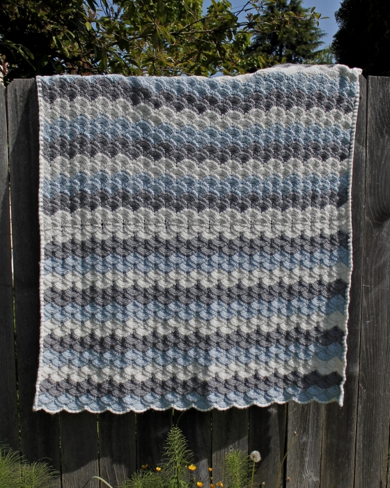 Tunisian shell stitch crochet baby blanket, made with Cascade Yarns Cherub Chunky in blue, gray, cream
