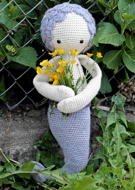 Purple Lalylala Mici the Mermaid holding buttercups