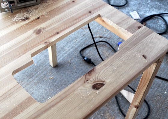 Table with hole cut into it for sewing machine