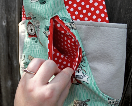 Showing red and white polka dot fabric lining the pocket of a 241 Tote