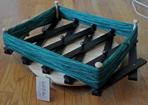 DIY Yarn Swift with green yarn on it