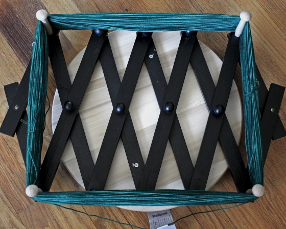 DIY yarn swift made from an expandable shoe rack and a lazy susan